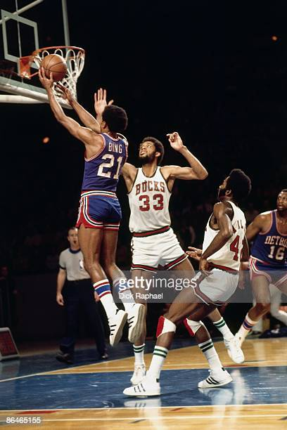 Dave Bing of the Detroit Pistons shoots a layup against Kareem AbdulJabbar of the Milwaukee Bucks during a game played in 1974 at the Mecca in...
