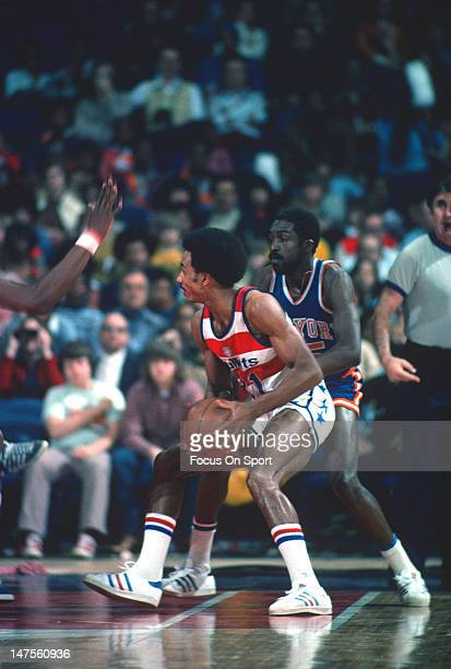 Dave Bing of the Washington Bullets looks to put a move on Earl Monroe of the New York Knicks during an NBA basketball game circa 1976 at the Capital...