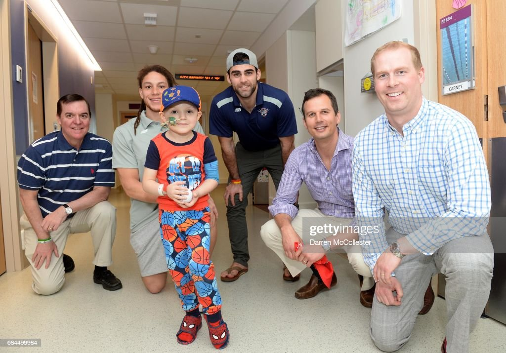 Dave Bjork, Boston Lacrosse Cares, Boston Cannon players Josh Hawkins and James Fahey, Mike Jezienicki, Boston Lacrosse Cares, and Ryan Hurd, Boston Lacrosse Cares, visit Liam at Boston Children's Hospital on May 18, 2017 in Boston, Massachusetts.