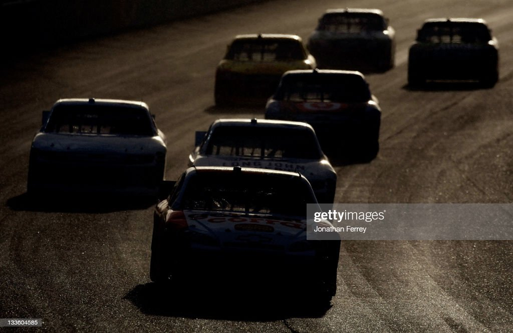 <a gi-track='captionPersonalityLinkClicked' href=/galleries/search?phrase=Dave+Blaney&family=editorial&specificpeople=183353 ng-click='$event.stopPropagation()'>Dave Blaney</a>, driver of the #35 Golden Corral Chevrolet, drives with a group of cars during the NASCAR Sprint Cup Series Ford 400 at Homestead-Miami Speedway on November 20, 2011 in Homestead, Florida.