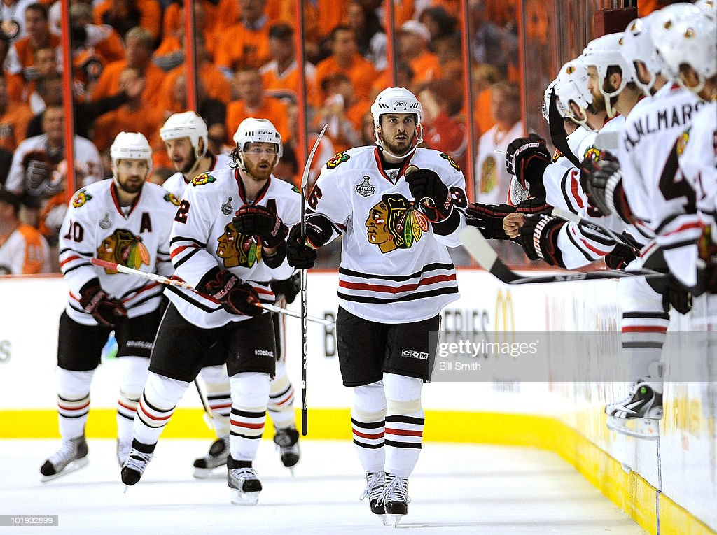 Dave Bolland of the Chicago Blackhawks celebrates a second period goal by teammate Patrick Sharp against the Philadelphia Flyers during Game Six of...