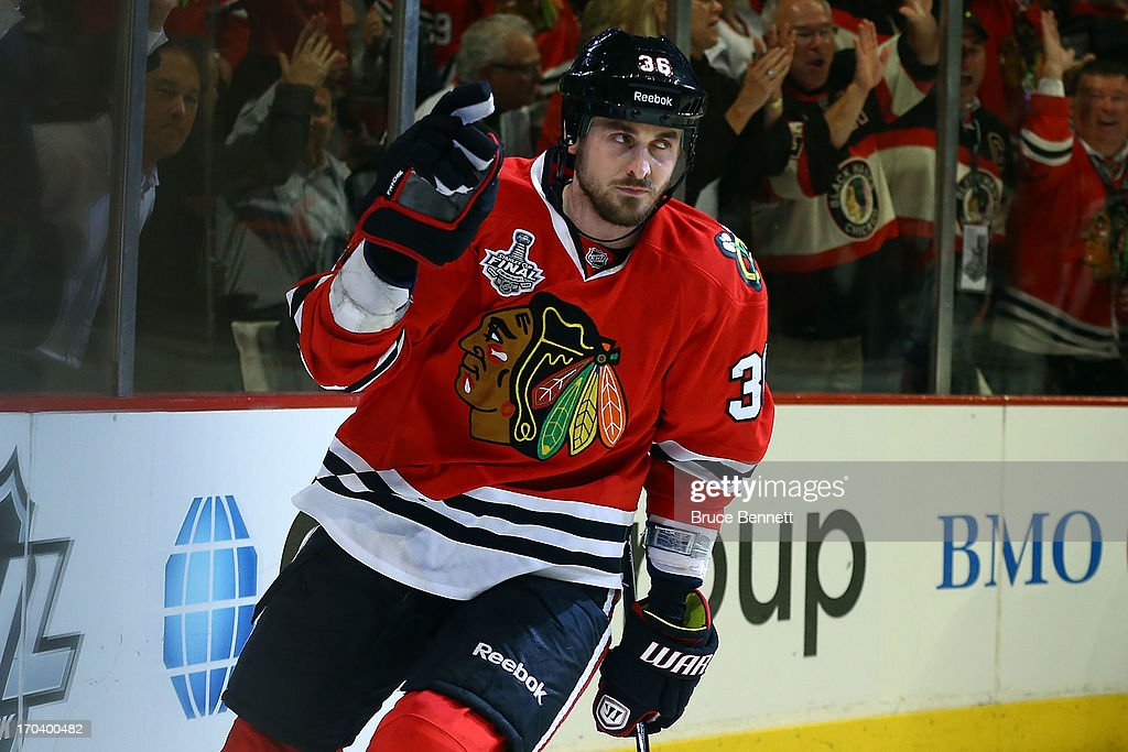 Dave Bolland of the Chicago Blackhawks celebrates after he scored a goal in the third period against the Boston Bruins in Game One of the NHL 2013...