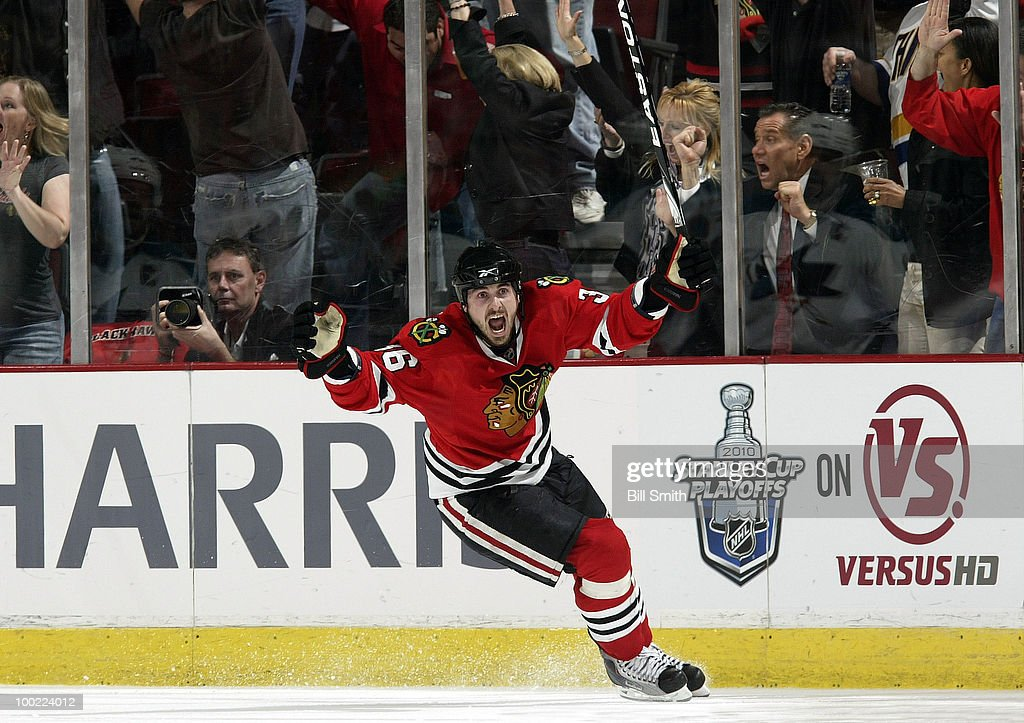Dave Bolland of the Chicago Blackhawks celebrates after scoring and giving the Blackhawks a 21 lead over the San Jose Sharks at Game Three of the...