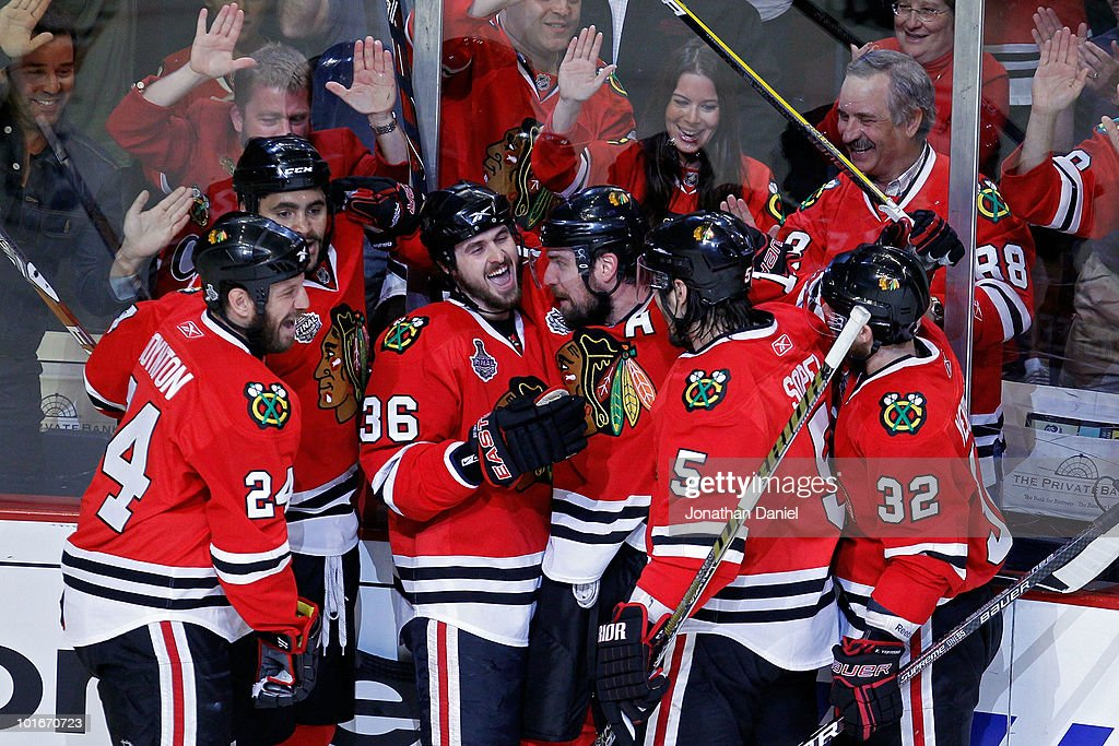 Dave Bolland of the Chicago Blackhawks celebrates with his teammates after scoring a goal in the first period against the Philadelphia Flyers in Game...