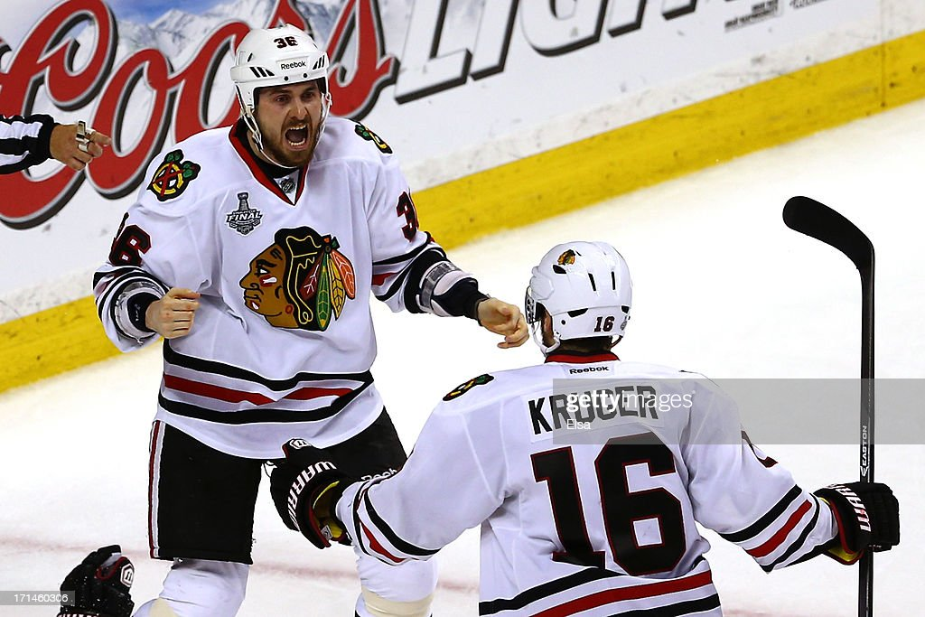 Dave Bolland #36 of the Chicago Blackhawks celebrates with Marcus Kruger #16 after scoring the game winning goal late in the third period against Tuukka Rask #40 of the Boston Bruins in Game Six of the 2013 NHL Stanley Cup Final at TD Garden on June 24, 2013 in Boston, Massachusetts.