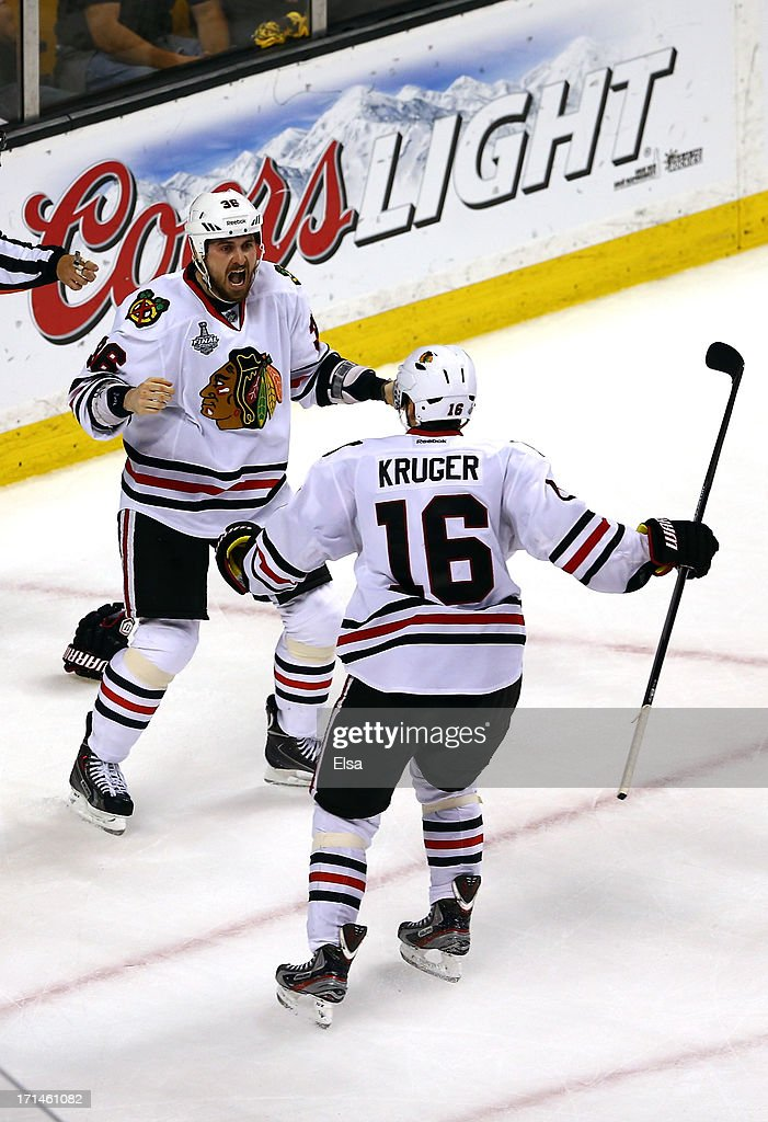 Dave Bolland of the Chicago Blackhawks celebrates with Marcus Kruger after scoring the game winning goal late in the third period against Tuukka Rask...