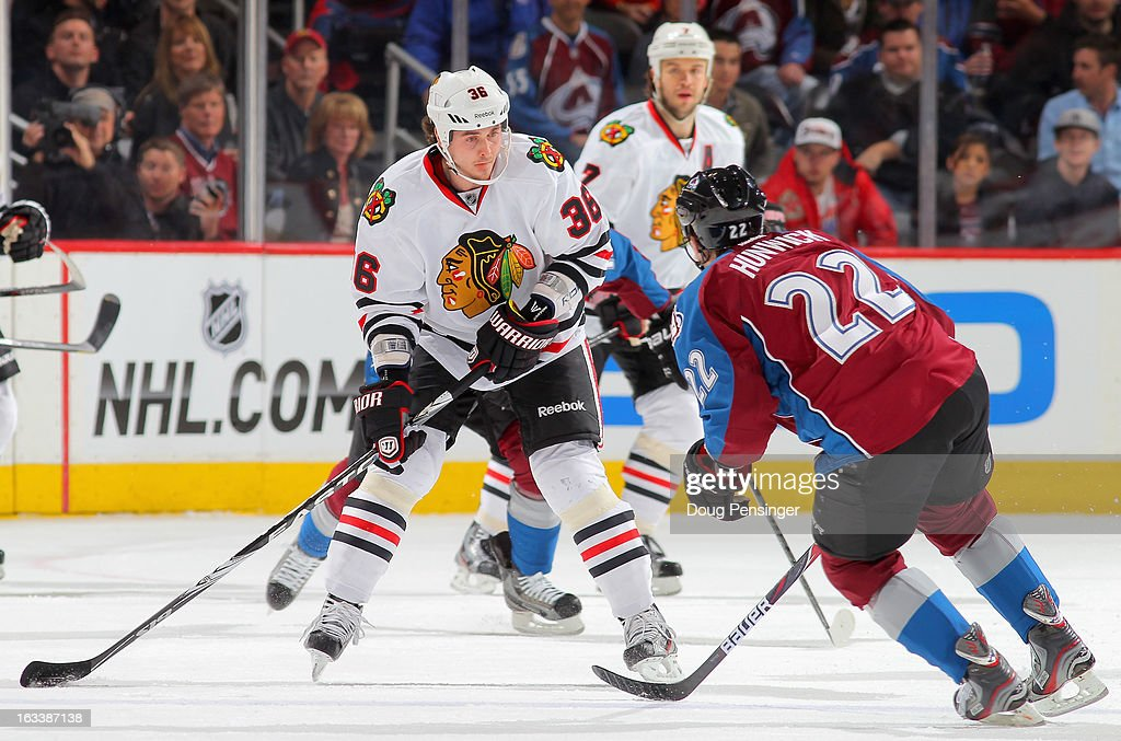 Dave Bolland #36 of the Chicago Blackhawks controls the puck against <a gi-track='captionPersonalityLinkClicked' href=/galleries/search?phrase=Matt+Hunwick&family=editorial&specificpeople=2284766 ng-click='$event.stopPropagation()'>Matt Hunwick</a> #22 of the Colorado Avalanche at the Pepsi Center on March 8, 2013 in Denver, Colorado. The Avalanche defeated the Blackhawks 6-2 to end the Chicago's 30 game undefeated streak.