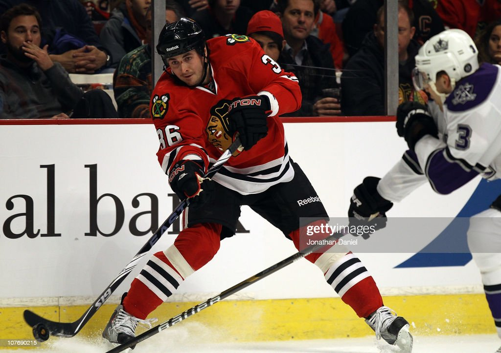 Dave Bolland of the Chicago Blackhawks fires a shot past Jack Johnson of the Los Angeles Kings at the United Center on December 19 2010 in Chicago...