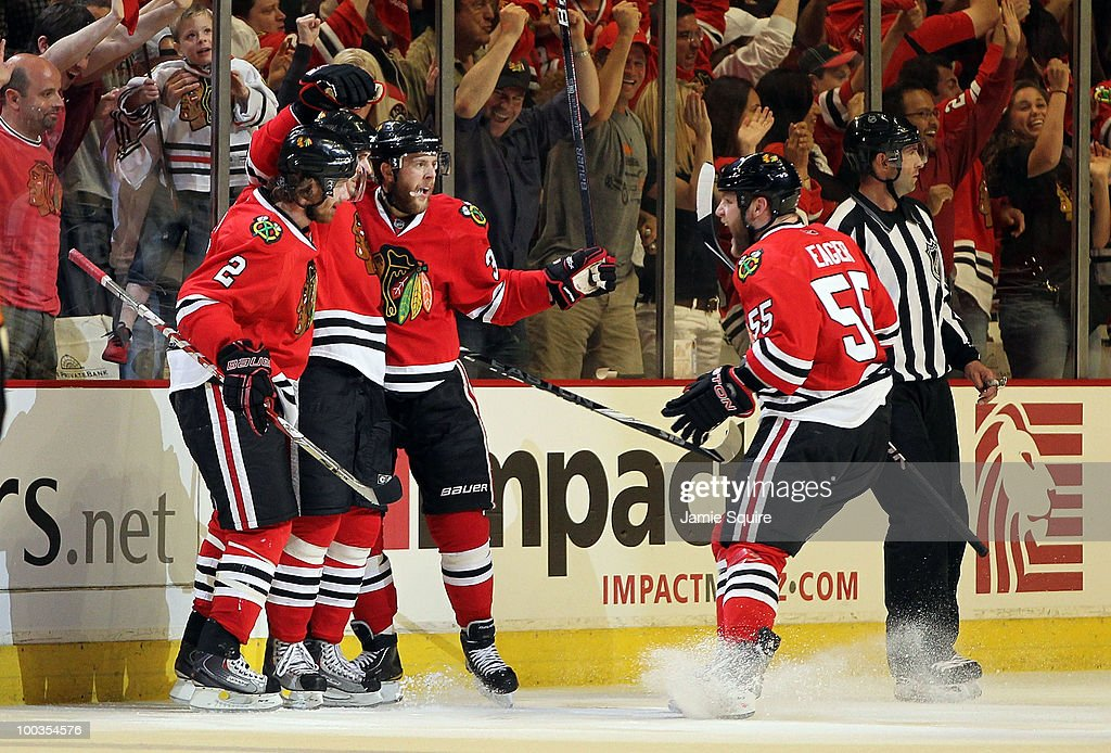 Dave Bolland #36 of the Chicago Blackhawks reacts with teammates Duncan Keith #2, Kris Versteeg #32 and Ben Eager #55 after Bolland's second period goal while taking on the San Jose Sharks in Game Four of the Western Conference Finals during the 2010 NHL Stanley Cup Playoffs at the United Center on May 23, 2010 in Chicago, Illinois.