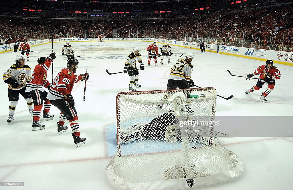 Dave Bolland of the Chicago Blackhawks scores a goal in the third period against goalie Tuukka Rask of the Boston Bruins in Game One of the 2013 NHL...