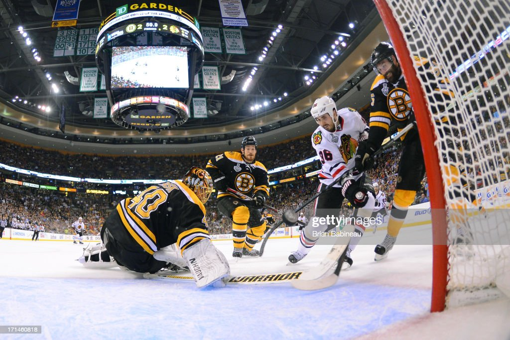 Dave Bolland of the Chicago Blackhawks scores a goal to win the game against the Boston Bruins in Game Six of the Stanley Cup Final at TD Garden on...