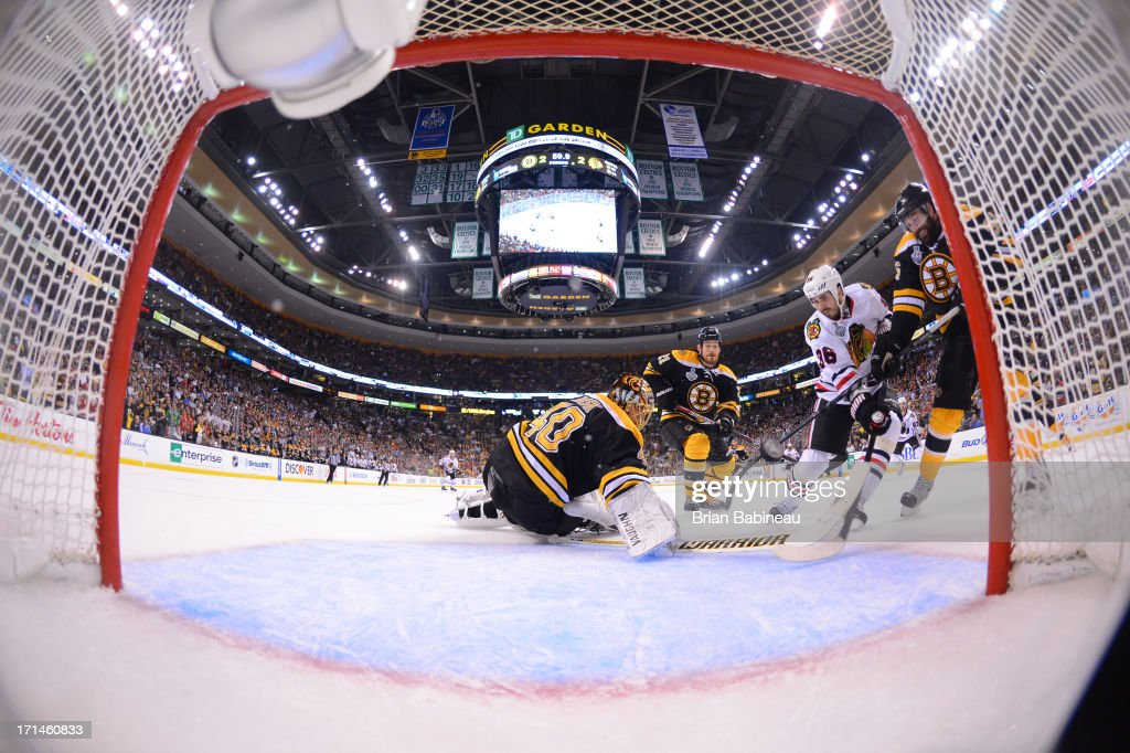 Dave Bolland #36 of the Chicago Blackhawks scores a goal to win the game against the Boston Bruins in Game Six of the Stanley Cup Final at TD Garden on June 24, 2013 in Boston, Massachusetts.