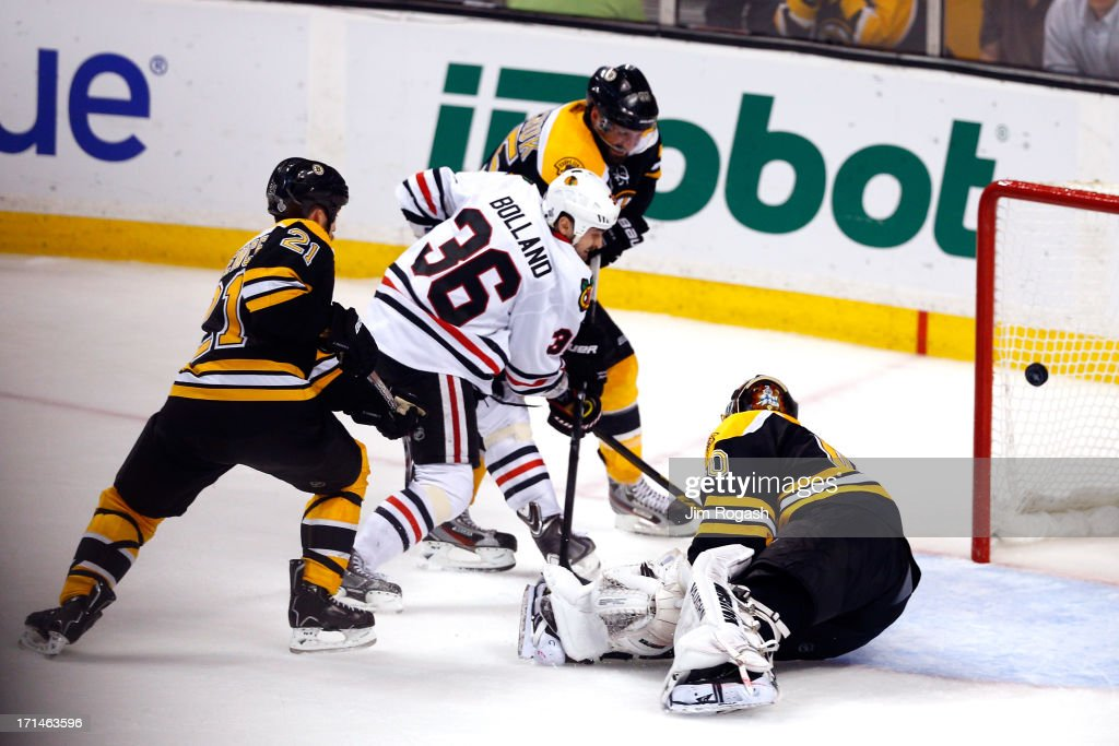 Dave Bolland of the Chicago Blackhawks scores past Tuukka Rask of the Boston Bruins in the third period in Game Six of the 2013 NHL Stanley Cup Final...