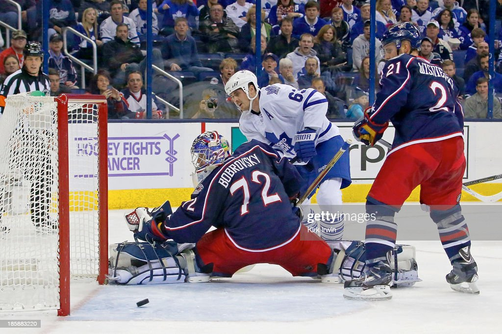 Dave Bolland of the Toronto Maple Leafs beats Sergei Bobrovsky of the Columbus Blue Jackets for a goal during the third period on October 25 2013 at...