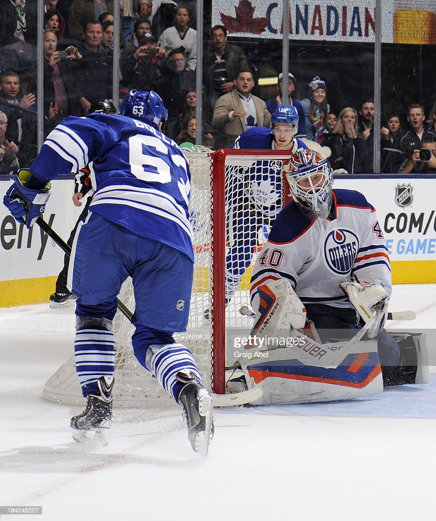 Dave Bolland #63 of the Toronto Maple Leafs scores the overtime goal on <a gi-track='captionPersonalityLinkClicked' href=/galleries/search?phrase=Devan+Dubnyk&family=editorial&specificpeople=2089794 ng-click='$event.stopPropagation()'>Devan Dubnyk</a> #40 of the Edmonton Oilers during NHL game action October 12, 2013 at Air Canada Centre in Toronto, Ontario, Canada.