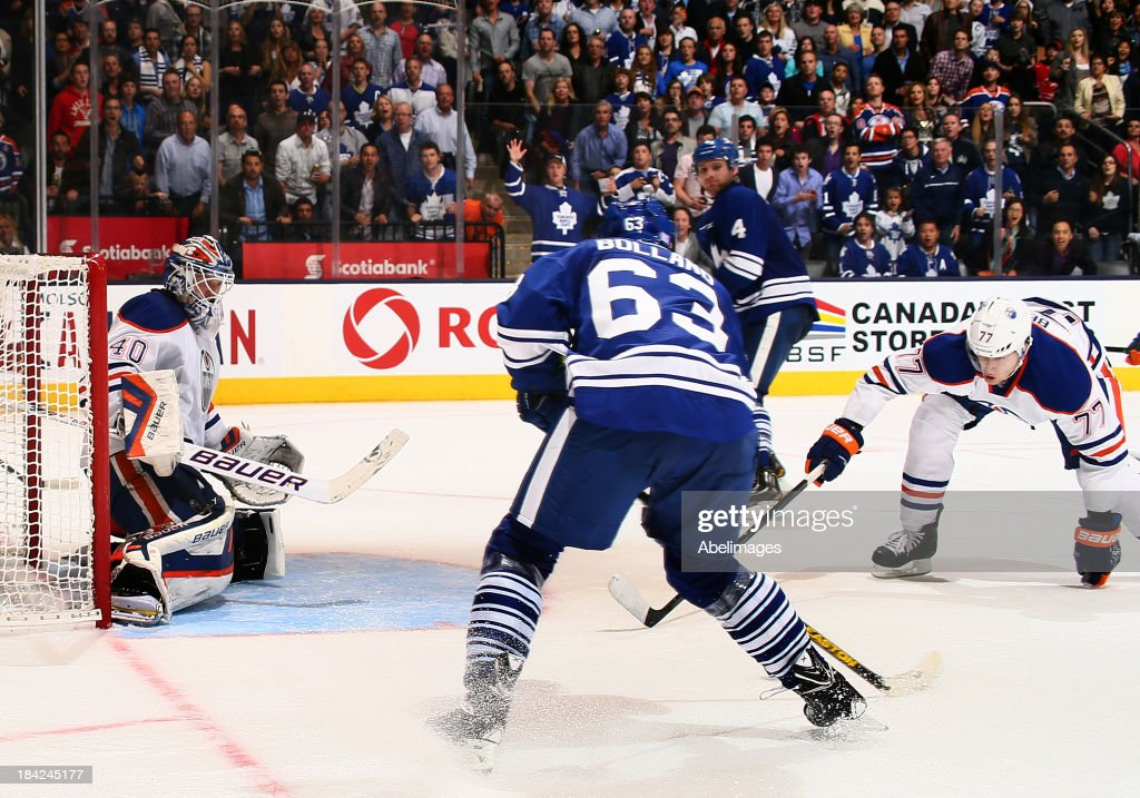 Dave Bolland #63 of the Toronto Maple Leafs scores the overtime winning goal on <a gi-track='captionPersonalityLinkClicked' href=/galleries/search?phrase=Devan+Dubnyk&family=editorial&specificpeople=2089794 ng-click='$event.stopPropagation()'>Devan Dubnyk</a> #40 of the Edmonton Oilers during NHL action at the Air Canada Centre October 12, 2013 in Toronto, Ontario, Canada.