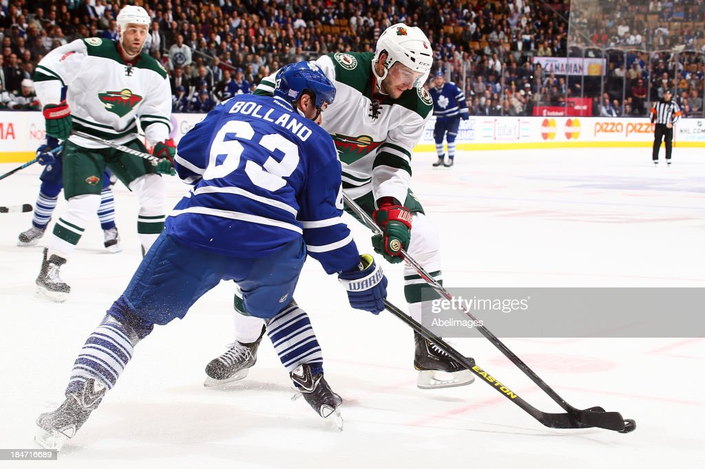 Dave Bolland #63 of the Toronto Maple Leafs stops <a gi-track='captionPersonalityLinkClicked' href=/galleries/search?phrase=Marco+Scandella&family=editorial&specificpeople=5408903 ng-click='$event.stopPropagation()'>Marco Scandella</a> #6 of the Minnesota Wild during NHL action at the Air Canada Centre October 15, 2013 in Toronto, Ontario, Canada.
