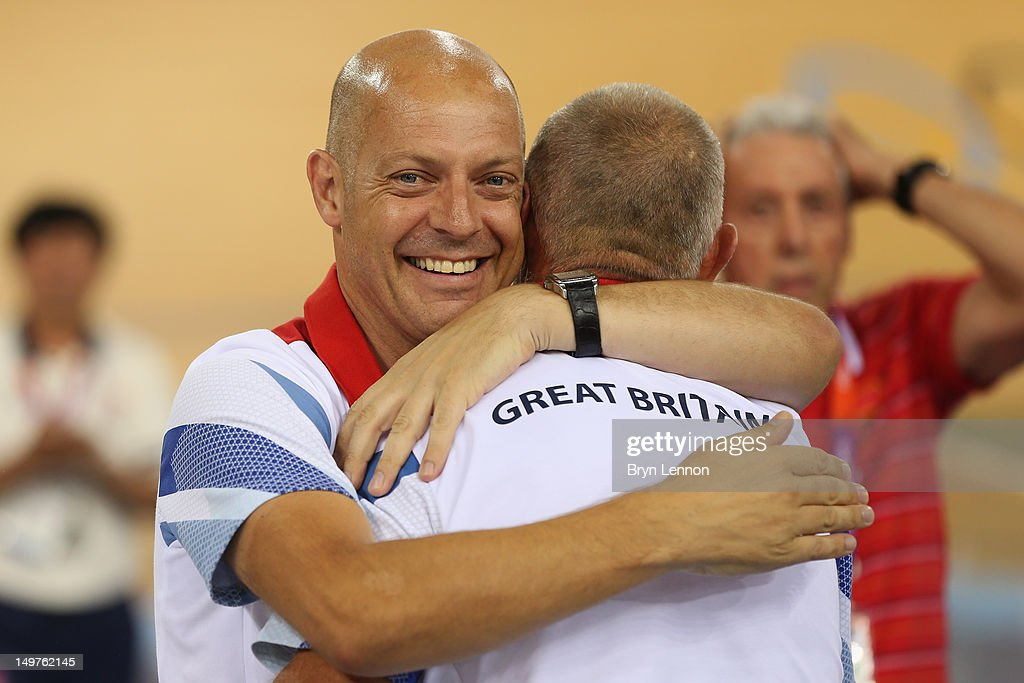 <a gi-track='captionPersonalityLinkClicked' href=/galleries/search?phrase=Dave+Brailsford&family=editorial&specificpeople=3000000 ng-click='$event.stopPropagation()'>Dave Brailsford</a>, British Cycling Perfromance Director hugs coach <a gi-track='captionPersonalityLinkClicked' href=/galleries/search?phrase=Shane+Sutton&family=editorial&specificpeople=3000462 ng-click='$event.stopPropagation()'>Shane Sutton</a> after Victoria Pendleton of Great Britain's gold medal-winning display in the Women's Keirin Track Cycling final on Day 7 of the London 2012 Olympic Games at Velodrome on August 3, 2012 in London, England.