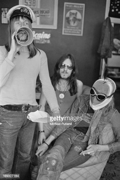 Dave Brock and Ian 'Lemmy' Kilmister of space rock group Hawkwind with a masked companion 17th May 1973