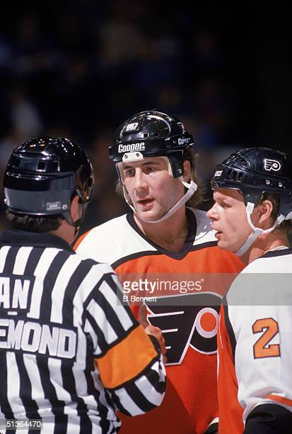 Dave Brown of the Philadelphia Flyers talks to an official during a game in 1987