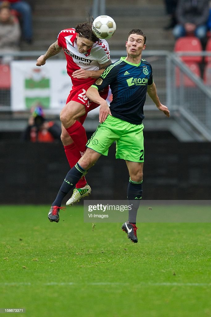 Dave Bulthuis of FC Utrecht, Derk Boerrigter of Ajax during the Dutch Eredivise match between FC Utrecht and Ajax Amsterdam at the Galgenwaard on December 23, 2012 in Utrecht, The Netherlands.