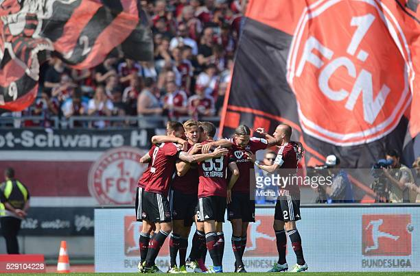 Dave Bulthuis of Nuernberg celebrates with teammates after scoring the opening/first goal during the Second Bundesliga match between 1 FC Nuernberg...