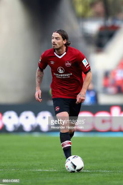 Dave Bulthuis of Nuernberg runs with the ball during the Second Bundesliga match between 1 FC Nuernberg and FC St Pauli at Arena Nuernberg on April 7...