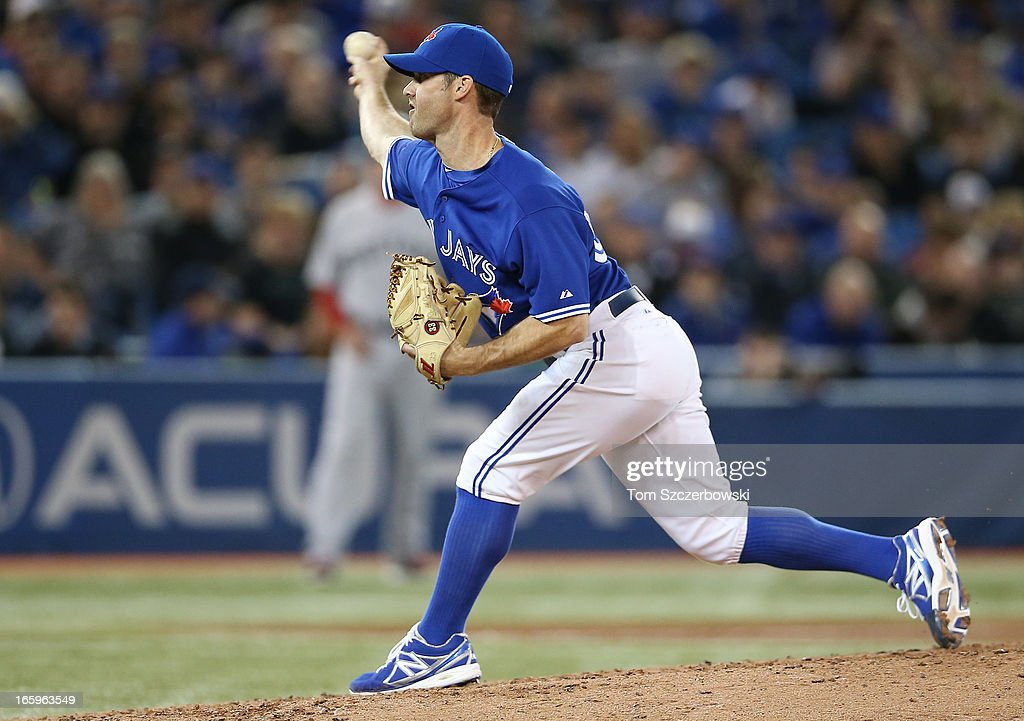 <a gi-track='captionPersonalityLinkClicked' href=/galleries/search?phrase=Dave+Bush&family=editorial&specificpeople=213204 ng-click='$event.stopPropagation()'>Dave Bush</a> #54 of the Toronto Blue Jays delivers a pitch during MLB game action against the Boston Red Sox on April 7, 2013 at Rogers Centre in Toronto, Ontario, Canada.