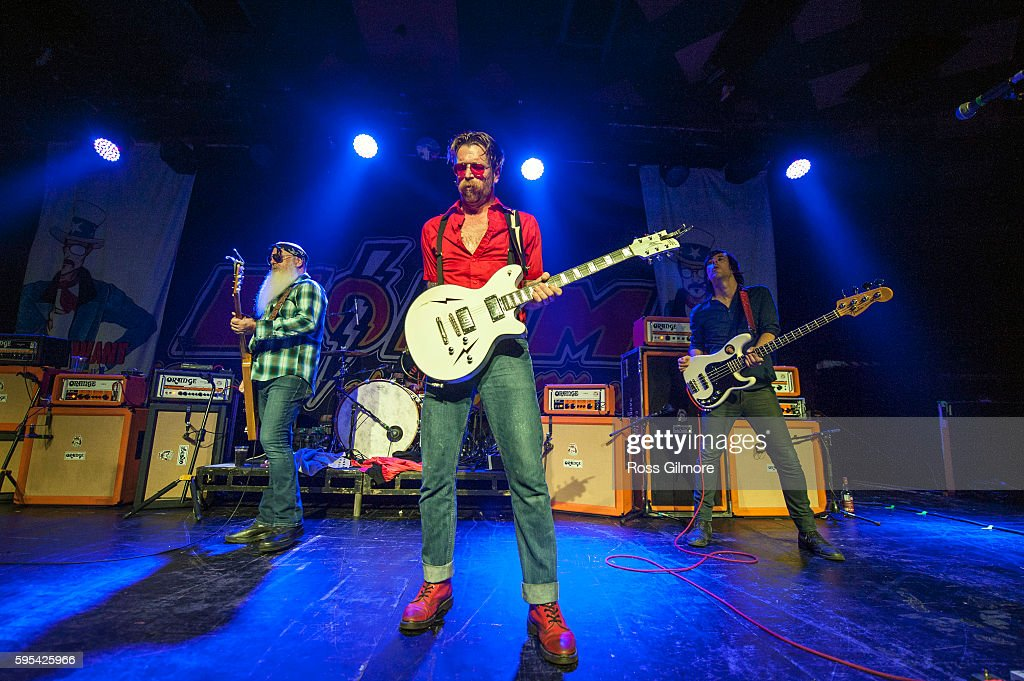 Dave Catching Jesse Hughes and Matt McJunkins of Eagles of Death Metal perform at Barrowlands Ballroom on August 25 2016 in Glasgow Scotland