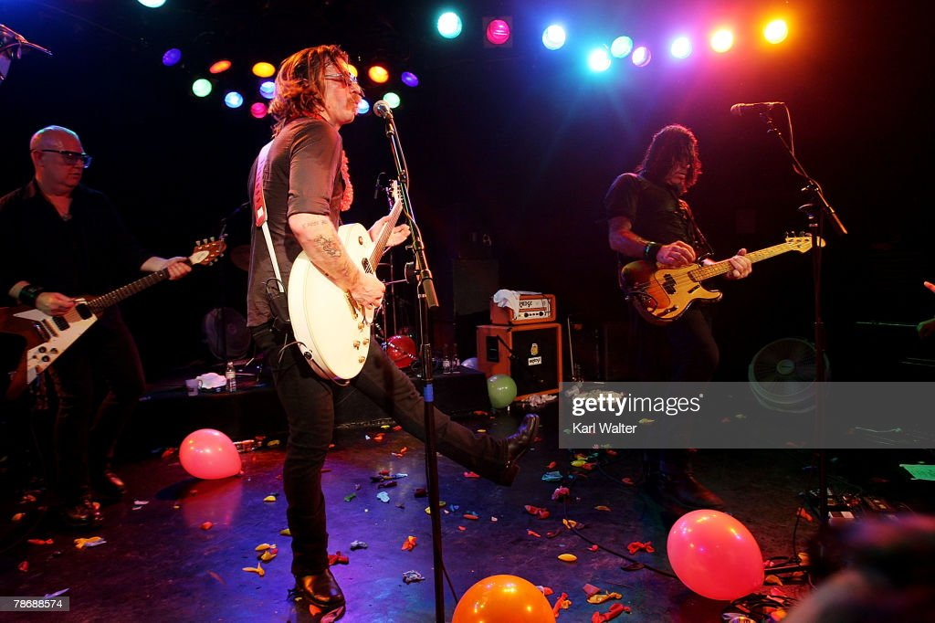 Dave Catching Jesse Hughes Josh Homme and Brian O'Connor of The Eagles of Death Metal performs a New Years Eve concert at the Roxy on Sunset on...