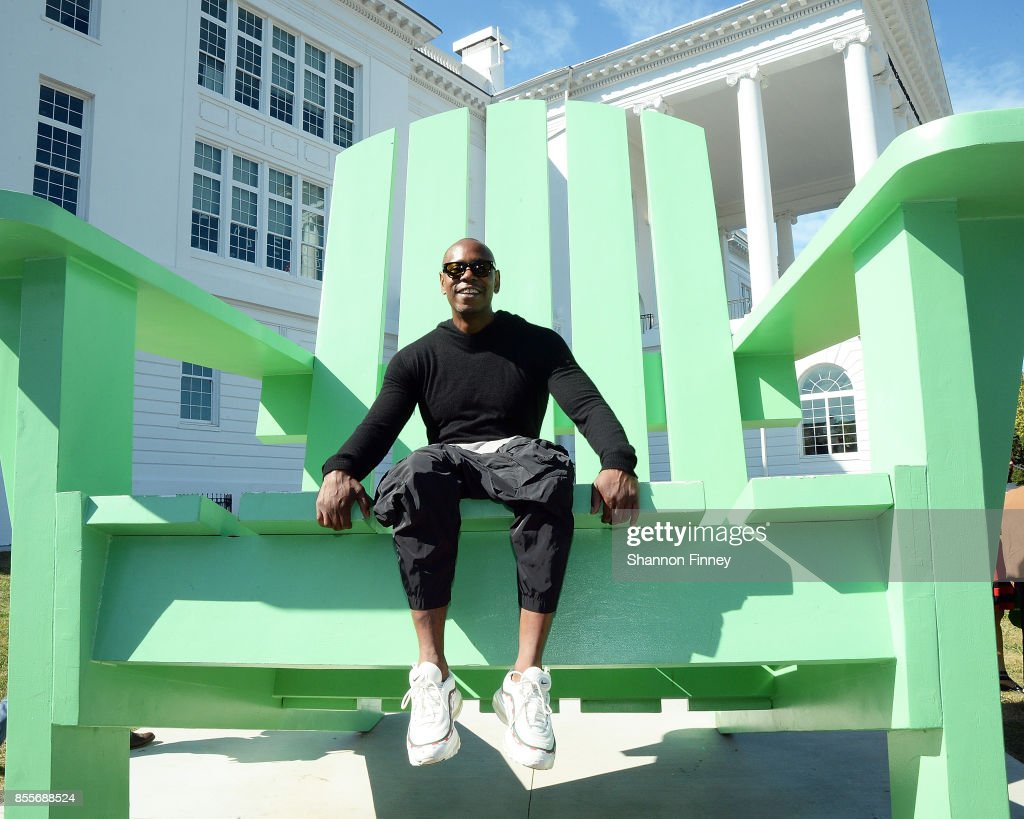 Dave Chappelle sits in the big green chair, a landmark on the campus of the Duke Ellington School of the Arts on September 29, 2017 in Washington, DC.
