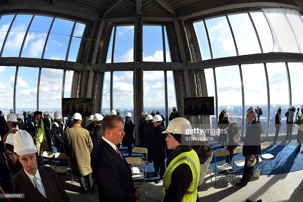 Dave Checketts (front, L), Chairman and CEO of Legends, along with officials from The Durst Organization, Legends Hospitality LLC and The Port Authority of New York & New Jersey give a preview to the news media of the One World Observatory site, the planned public observation deck under construction on the 100th floor of One World Trade Center April 2, 2013 in New York. AFP PHOTO/Stan HONDA