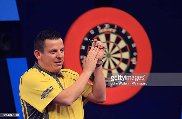 Dave Chisnall applauds the fans for their support after he loses to Gary Anderson during day thirteen of the William Hill World Darts Championship at...