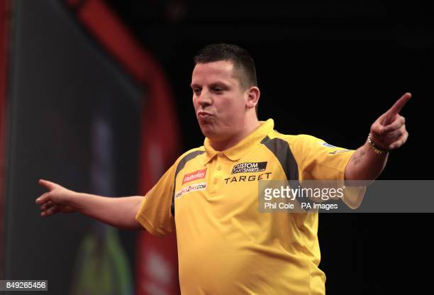 Dave Chisnall celebrates against Simon Whitlock during the Ladbrokescom World Darts Championship at Alexandra Palace London