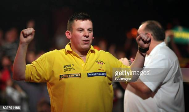 Dave Chisnall celebrates beating Tony O'Shea during the BDO 2010 Lakeside World Championships at Lakeside Country Club Frimley Green