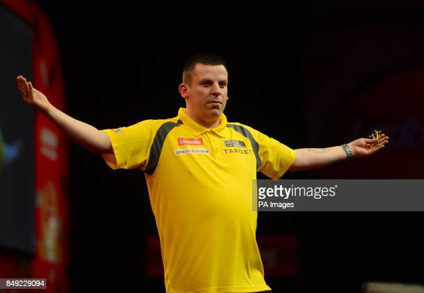 Dave Chisnall celebrates defeating Daryl Gurney during the Ladbrokescom World Darts Championship at Alexandra Palace London