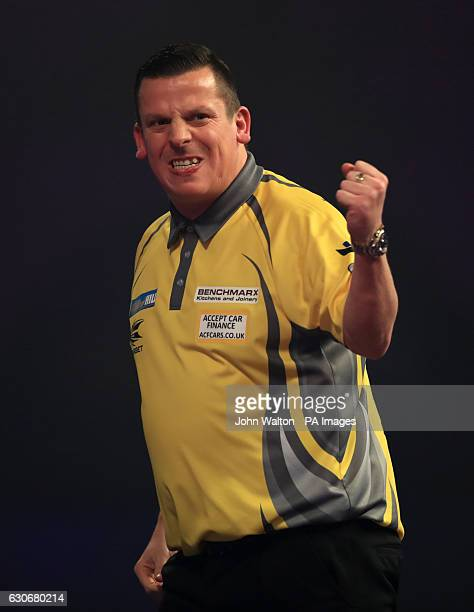 Dave Chisnall celebrates during his match against Gary Anderson during day thirteen of the William Hill World Darts Championship at Alexandra Palace...