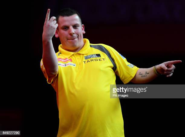 Dave Chisnall celebrates winning the third set during the Ladbrokescom World Darts Championship at Alexandra Palace London