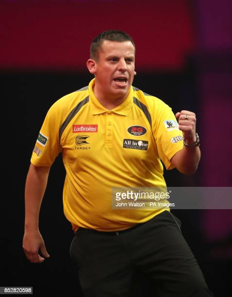 Dave Chisnall during his match against John Henderson during day three of The Ladbrokes World Darts Championship at Alexandra Palace London