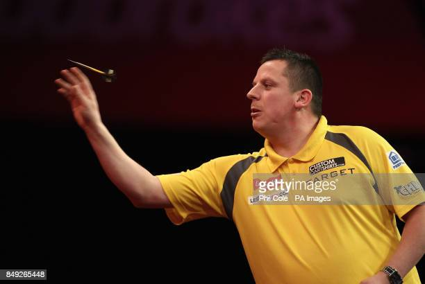 Dave Chisnall in action against Simon Whitlock during the Ladbrokescom World Darts Championship at Alexandra Palace London