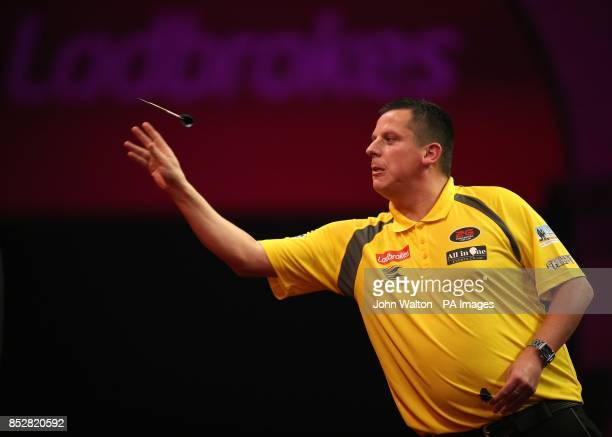 Dave Chisnall in action during his match against John Henderson during day three of The Ladbrokes World Darts Championship at Alexandra Palace London