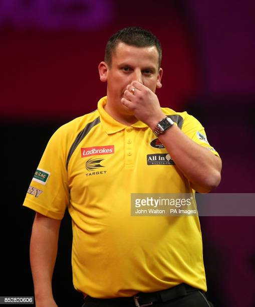 Dave Chisnall looks dejected on his way to loosing against John Henderson during day three of The Ladbrokes World Darts Championship at Alexandra...