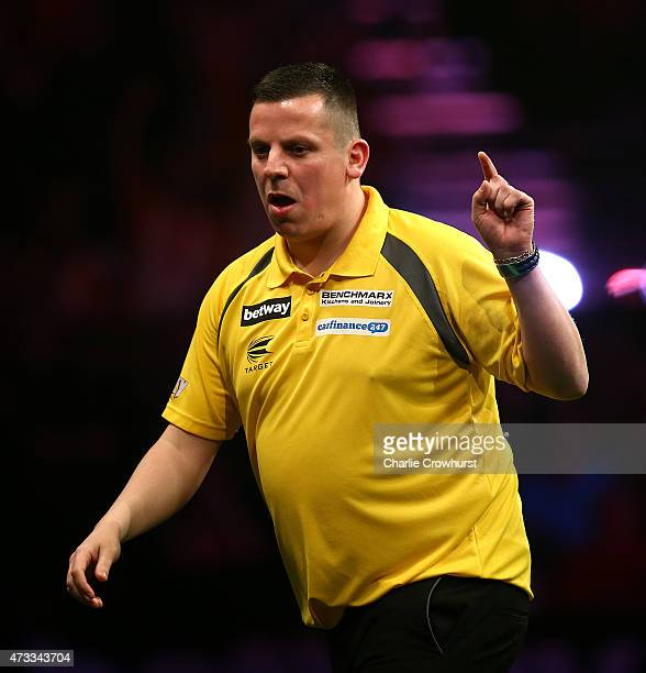 Dave Chisnall of England celebrates winning a leg during his match against Michael van Gerwen of Holland during the Betway Premier League at The...