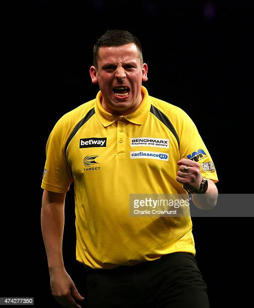 Dave Chisnall of England celebrates winning a leg during his semifinal match against Gary Anderson of Scotland during the Betway Premier League at...