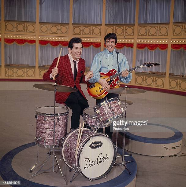 1968 Dave Clark from English pop group The Dave Clark Five posed with American singer and actor Trini Lopez on set of the 'Hippodrome Show' on...