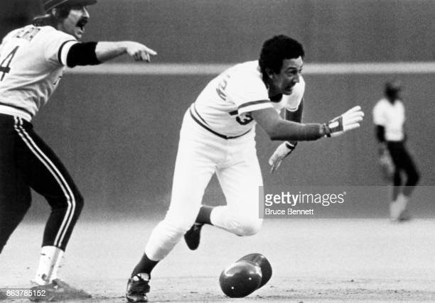 Dave Concepcion of the Cincinnati Reds runs to a base during an MLB game against the Pittsburgh Pirates circa 1980 at Riverfront Stadium in...