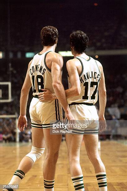 Dave Cowens and John Havlicek of the Boston Celtics chat during an NBA game circa 1970's at the Boston Garden in Boston Massachusetts NOTE TO USER...