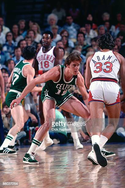 Dave Cowens of the Boston Celtics defends against Alvan Adams of the Phoenix Suns during a game played in 1976 at the Boston Garden in Boston...