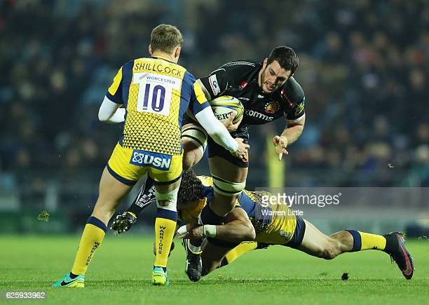 Dave Dennis of Exeter Chiefs is tackled during the Aviva Premiership match between Exeter Chiefs and Worcester Warriors at Sandy Park on November 26...