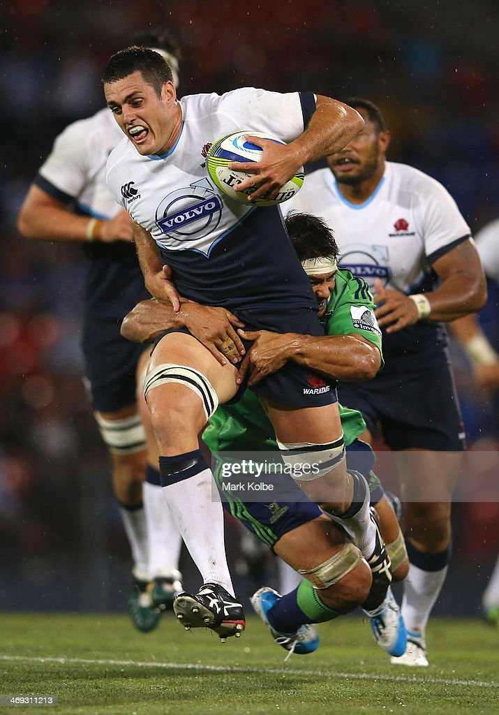 <a gi-track='captionPersonalityLinkClicked' href=/galleries/search?phrase=Dave+Dennis+-+Rugby+Player&family=editorial&specificpeople=2516880 ng-click='$event.stopPropagation()'>Dave Dennis</a> of the Waratahs is tackled during the Super Rugby trial match between the Waratahs and the Highlanders at Hunter Stadium on February 14, 2014 in Newcastle, Australia.